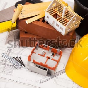 stock-photo-building-and-construction-equipment-on-blueprints-120049552
